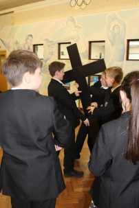 Jesus is given his cross